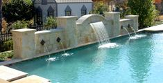 Raised, Arched Limestone Wall With Sconces And Waterfall - Westlake, Texas