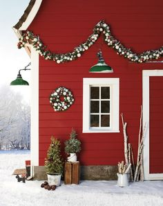 I wish our house & garage was barn red! And to have a stunning farmhouse door painted black. My dream!
