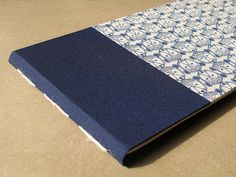 "IONA BINDING - Handmade albums themed mountain that measures 13,97"" x 6,88"".114. Covered with Japanese fabric."