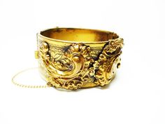 Wide Hinged Bracelet  Repousse Style with Safety by thejewelseeker