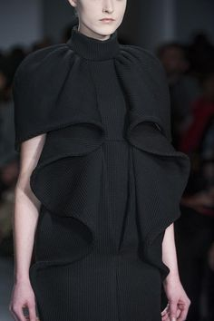 Beautifully structured black dress with elegant 3D construction  sculptural symmetry / Amaya Arzuaga fw14