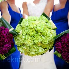hand-tied, super-green garden roses, green hydrangeas, and hosta leaves wrapped in ivory ribbon. Her bridesmaids carried similar bouquets made up of violet-magenta carnations with blue satin ribbon bouquet wraps.