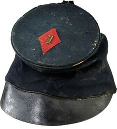 "Berdan's Sharpshooter's Officer's Cap. Only two regiments numbered ""1"" served in the First Division of the Third Army Corps: the 1st New York and the 1st U.S. Sharpshooters. The New York regiment mustered out in May, 1863, and the configuration of the Third Corps badge as an elongated diamond rather than a tilted square, as first issued, is thought to date no earlier than the Fall of 1863, which leaves the 1st US Sharpshooter as the only candidate for the cap."