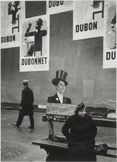 Dubo, Dubon, Dubonnet, Paris, 1934 by André Kertész