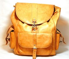 Durable Vintage Brown Leather Backpack  ~  Color: Tan/Brown    Condition: Aged to perfection!  (small stain on back as seen in picture)