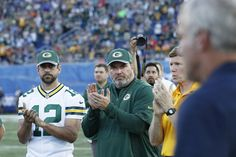 Brett Favre Photos Photos - Aaron Rodgers #12 and head coach Mike McCarthy of the Green Bay Packers acknowledge Hall of Famer Brett Favre as he is introduced after the NFL Hall of Fame Game against the Indianapolis Colts was cancelled due to poor field conditions at Tom Benson Hall of Fame Stadium on August 7, 2016 in Canton, Ohio. - Hall of Fame Game - Green Bay Packers v Indianapolis Colts