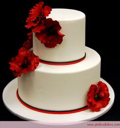 love the placement of the flowers ...only i would want the flowers to be white and the red ribbon to be  plum