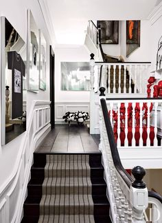 The townhouse's stairway doubles as a gallery space for contemporary art   archdigest.com