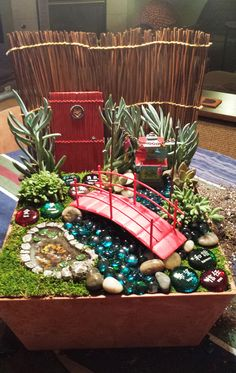 Oriental fairy garden (created by Janet C. in CA) with a door I made. So sweet. Other doors found at warmweenies.etsy.com