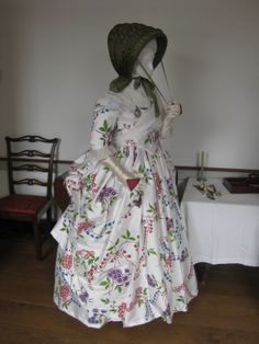 Fashionable lady in polonaise gown, c. 1780. Polonaise gown, hand-painted and hand-sewn reproduction of extant ensemble at the Metropolitan Museum of Art; silk calash, replica of extant item in the collection of Pottsgrove Manor. Exotic goods from the East were always highly desirable in fashionable European society, whether they were home furnishings of rare woods, ladies' ivory fans, or textiles for expensive garments.