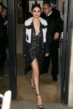 Gomez showed some leg in Paris, donning a sequin dress, suede jacket with fur touches by Rodarte & Other Stories, and slicked back locks.