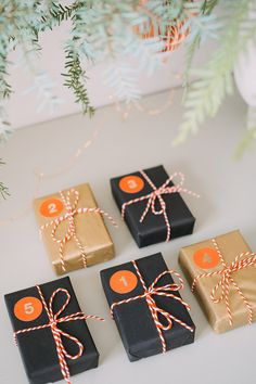 Make your own advent calendar parcels with red foiled stickers and red and white twine.