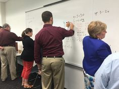 Executive students using formulas to find a solution.