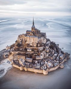 The enchanting island ~ Mont Saint-Michel, France Photo: Awesome . - Best Places to Visit X Beautiful Castles, Beautiful Places, Cool Places To Visit, Places To Travel, Mont Saint Michel France, Mont Sant Michel, Belle France, France Photos, Photos Voyages