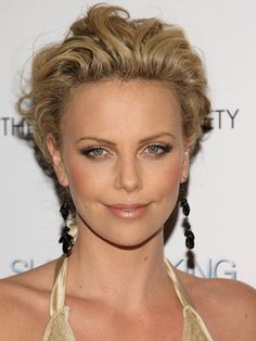 Charlize Theron Hair: Styles and Colors Through the Years - Charlize Theron has always taken risks with her style and hair. See the most inspiring looks for Charlize Theron hair, including the latest look: a hot pixie.