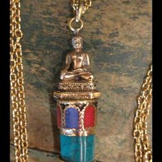 """Meditation Buddha Pendant Brass Meditation Buddha sits atop a point of Turquoise Lapis and Coral. Wear as a pendant or hand from a bag or in your car or office... Anywhere you'd like to feel some peace or need a reminder to breathe. Chain not included. 3"""" long New Jewelry Necklaces"""