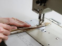 Wrap the fabric around the cording and stitch along the right side. If you don't have a single welt cord foot attachment for your sewing machine, you can use a zipper foot attachment. Open up and lay the seams flat as you sew across connections in the welt cord fabric.