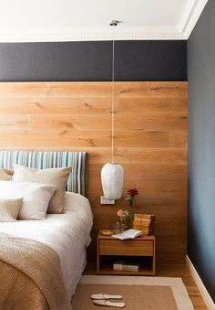 Contemporary bedroom with natural wood wall and dark colors accents