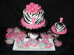 hot pink and zebra 1st birthday cake with matching smash cake and cookies.