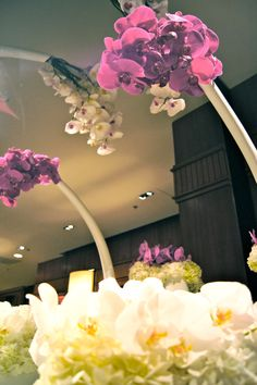 Crescent hanging orchids by Granville Island Florists