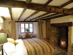 Hay Meadow Farm Guest House, Ashwater, West Devon. Exposed beams and an inglenook fireplace with log burner give the Clover Room heaps of character organicholidays.com/at/3624.htm Inglenook Fireplace, Farm Shop, Log Burner, Exposed Beams, Bed And Breakfast, Devon, Room, House, Furniture