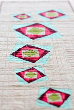 Great colors, fun pattern in this foundation-pieced table runner from Christina Lane, The Sometimes Crafter.