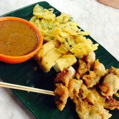 Prawn & squid fritters, deep fried tofu with kuah kacang (peanut dipping sauce).