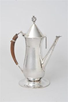 Guild Handicraft  silver coffee pot  London 1904.   :   Designed by Charles Ashbee for Hungarian aristocrat Tsombor de Szasz. Rosewood handle.
