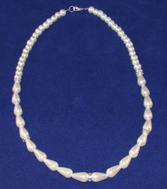 Ivory and cream imitation pearl and diamante necklace