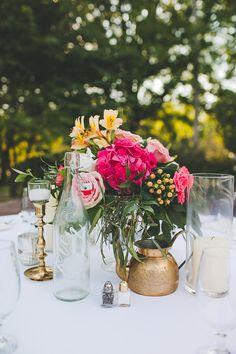 fuchsia centerpiece - photo by Teale Photography http://ruffledblog.com/colorful-boho-wedding-at-historic-cedarwood