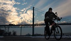 A man rides his bicycle along Windsor's riverfront in frigid temperatures just before sunset, Saturday, January 5, 2012. (DAX MELMER / The Windsor Star)