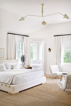 Warm white bedroom filled with texture