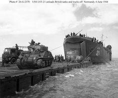 USS LST-21 unloads British tanks and trucks off Normandy, June 6, 1944