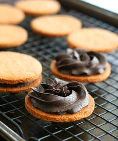 Low Carb Peanut Butter Chocolate Sandwich Cookies - Rich dark chocolate frosting sandwiched between two soft, tender peanut butter cookies. Low carb, gluten-free and grain-free.  Total NET CARBS = 3.7 g