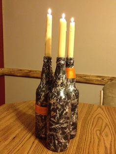Camo candle holders- Great idea!! Also use small liquor bottles and cover them, that would be great for birthday candles.
