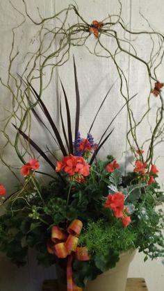 A pot of geraniums need not be boring.