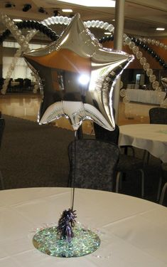 Pick up a star balloons in your schools color and place them at varying heights on each table for a simple centerpiece that is classic and festive!