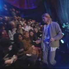 Kurt Cobain signing autographs at the end of the performance on MTV Unplugged. Sony Music Studios, New York, NY, US. 11/18/1993