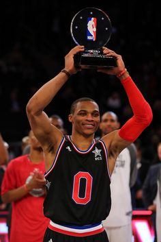 Westbrook has 41, West edges East in NBA All-Star Game - Russell Westbrook #0 of the Oklahoma City Thunder and the Western Conference celebrates after winning the MVP Trophy after defeating the Eastern Conference in the 2015 NBA All-Star Game at Madison Square Garden on February 15, 2015 in New York City. (Photo by Elsa/Getty Images)