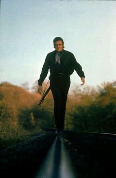 """""""Country music star Johnny Cash walking along the line of a railway track with his guitar strapped across his back."""" Location: Nashville, TN, US. Date taken: November Photographer: Michael Rougier. Johnny Cash June Carter, Johnny Y June, Johnny Depp, Country Music Stars, Country Singers, Country Artists, My Guy, The Man, Arkansas"""