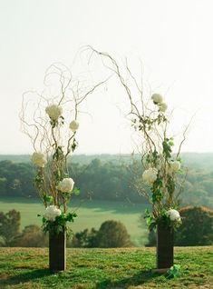 Arco di fiori matrimonio rami