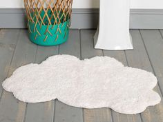 A cushiony cloud bath mat. | 32 Insanely Awesome And Inexpensive Things You Need For Your Bathroom