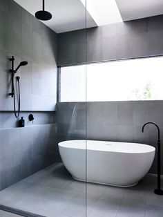 Amazing ideas for wet rooms: Top 12 - Contemporary and minimal bathroom Ultra-minimal and contemporary wet room, covered with square gray tiles in an oval bathroom and complete with Bathroom Design Luxury, Bathroom Layout, Modern Bathroom Design, Bathroom Ideas, Bathroom Storage, Bathroom Mirrors, Master Bathrooms, Bathroom Cabinets, Bath Ideas