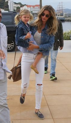 Passing on her jeans! Gisele Bundchen and her daughter Vivian were both clad in matching j...