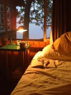 The comfort of the cabin bed and a good book. listen to the sounds at the lake at night. watch the fireflies twinkle. cozy cottage with lake view Lake Cabins, Cabins And Cottages, Lake Cottage, Cozy Cottage, Cozy Cabin, Cozy Place, Cabins In The Woods, Lake Life, Hygge