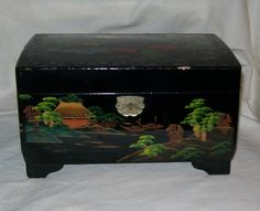 This is a beautiful and clean jewelry box with music box, it shows some wear on the out side. The box is 4 3/4 inches tall and 8 1/4 inches long.
