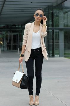 Shop this look for $496:  http://lookastic.com/women/looks/beige-blazer-and-white-crew-neck-t-shirt-and-black-jeans-and-beige-heels/883  — Beige Silk Blazer  — White Crew-neck T-shirt  — Black Jeans  — Beige Heels