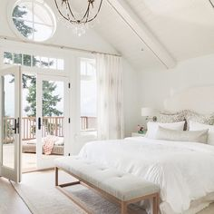 A beautiful bedroom design by @kellydeckdesign. That view outside isn't so bad either. | @scoutandnimble Instagram