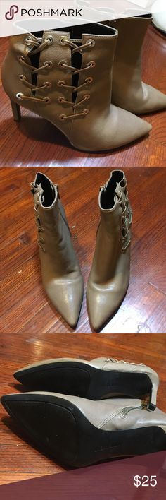 Nine West size 6.5 booties Beautiful lace-up and zippered design, dresses well with jeans or for a night out. My lifestyle just doesn't allow me to get much use out of these beauties, so I thought I would find them a new home. Nine West Shoes Heeled Boots