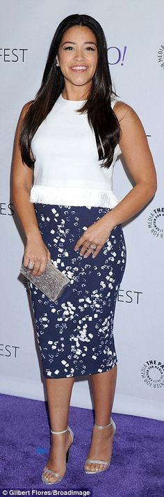 Gina Rodriguez strikes a pose in tight pencil skirt at PaleyFest #dailymail